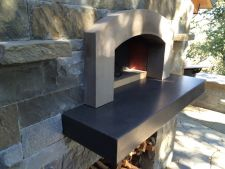 Custom brick and concrete outdoor fireplace