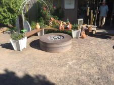 Custom circular concrete fire pit