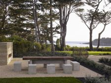 Custom made outdoor concrete fireplace and rectangular table