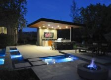 Beautifully created outdoor patio & custom firepit, photo credit: Huettl Landscape